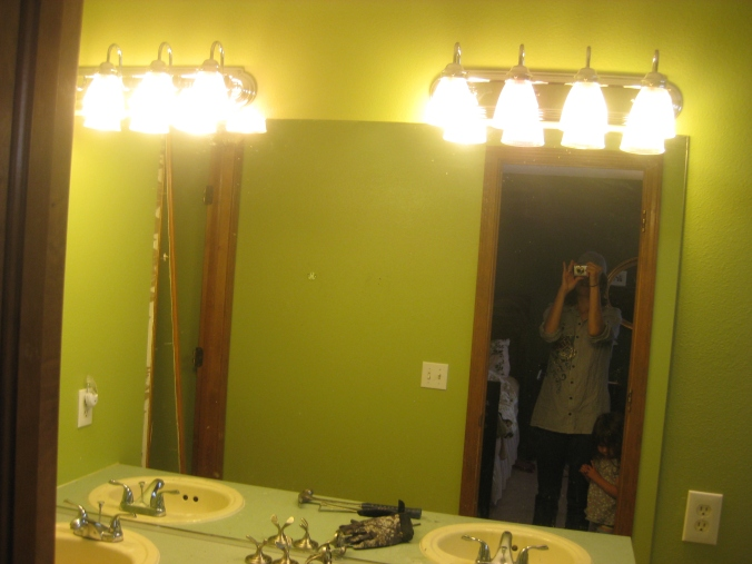 Asparagus green paint shown in the wall-sized mirror.
